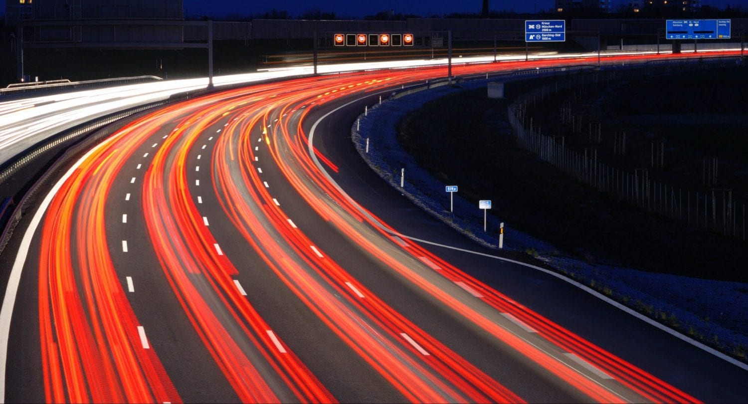 long exposure photography of vehicles on freeway in night